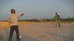 Make friends and have fun. Sean and Rishabh fly a kite at the bank of Yamuna river, Vrindavan, India. A still from the multi-award winning film 'Reconnection'.