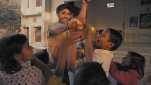 Open yourself up to people. Sean Fletcher, a lead character of the multi-award winning film 'Reconnection' with children at Sundipani Muni charitable school in Vrindavan, India. A still from the film.