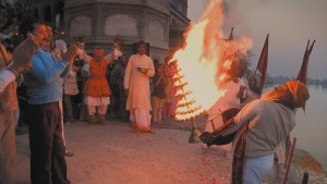 Marvel at an ancient fire ceremony. Yamuna arati, a daily worshiping of the sacred river. Keshi Ghat, Vrindavan, India. A still from the multi-award winning film 'Reconnection'.