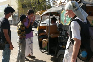 The crew watches as Radha Mohan Rajani, the 1st AC and a translator, talks the driver through  the scene where a rickshaw hits Armand Gachet (left), film lead actor. Let's just hope he understands the 'breaks' part right! On the set of the 'Reconnection', a multi-award winning film.