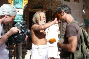 An unusual make-up, native style. A local sadhu decorates Armand Gachet, the lead actor of the film, with a sandal wood paste. At the set of  the 'Reconnection', a multi-award winning film.
