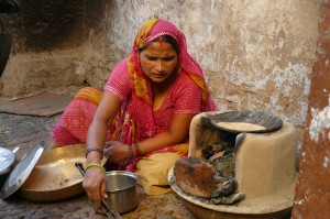 Cooking on a stove that works on a cow dung. During the village lunch scene of the 'Reconnection', an award-winning film.