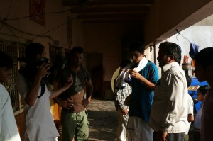 Discussing the village lunch scene. Left to right: Maksim Varfolomeev, the director of the film, Armand Gachet, the lead actor, Radha Mohan Rajani, 1st AC and translator, Raman Gauttam, the village lunch host. On the set of the 'Reconnection', a multi-award winning film.