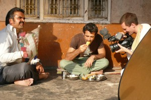 One man eats.. Filming the village lunch scene from the 'Reconnection', a multi-award winning film.
